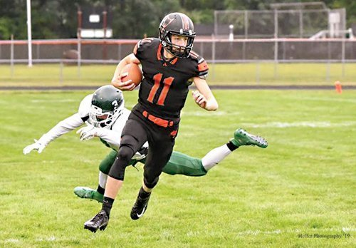Almont rolls  to 54-6 win  in opener