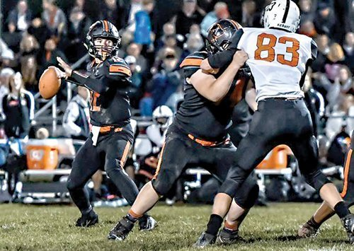 Almont wins 48-14, secures playoff spot