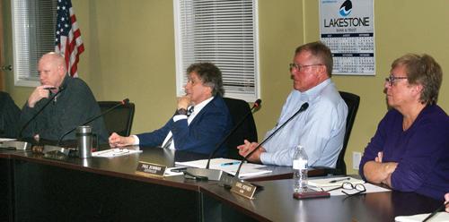 Full house hears development plan
