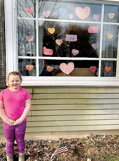 Girl's colored hearts help to bring smiles