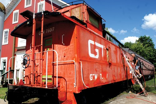 Old caboose gets new coat of paint