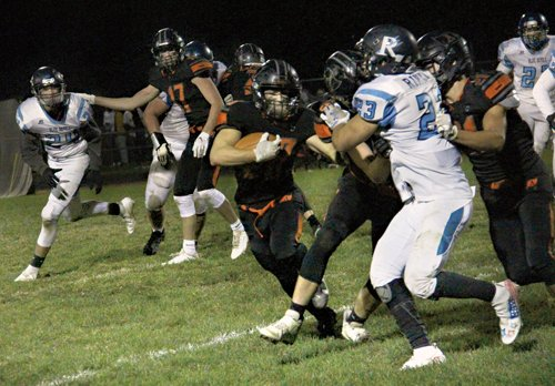 Almont returns with OT win