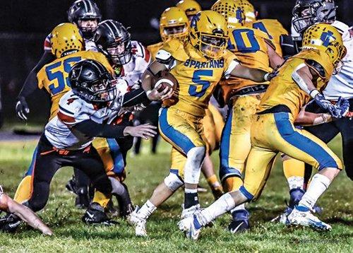 Spartans stun Raiders, 28-14