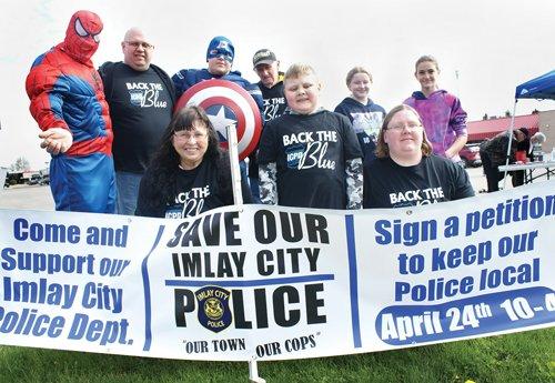 More than 700 rally to save police